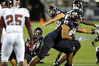 25 October 2011:  FIU kicker Jack Griffin (38) watches as his field goal attempt sails through the uprights in the second quarter as the FIU Golden Panthers defeated the Troy University Trojans, 23-20 in overtime, at FIU Stadium in Miami, Florida.