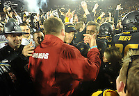 NWA Media/Michael Woods --11/28/2014-- w @NWAMICHAELW...University of Arkansas coach Bret Bielema talks with Missouri coach Gary Pinkel after Fridays game against Missouri at Faurot Field in Columbia Missouri.