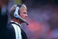 OAKLAND, CA - Head coach Jon Gruden of the Oakland Raiders watches the action during a game against the Dallas Cowboys at the Oakland Coliseum in Oakland, California in 2001. Photo by Brad Mangin