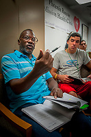 John Gilmore, left, poses a question to Zaccheus Lloyd, as Charles Wilson listens in, during a Bible Study class at the Phoenix Rescue Mission. Lloyd struggled with a gambling addiction, going through numerous rehabilitations and relapses before discovering a new depth to his faith that he credits with helping him break the grip of that addiction. He now helps others at the Phoenix Rescue Mission while also studying to become a christian minister.