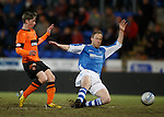 Ryan Gauld scores the opening goal for Dundee Utd as Steven Anderson challenges