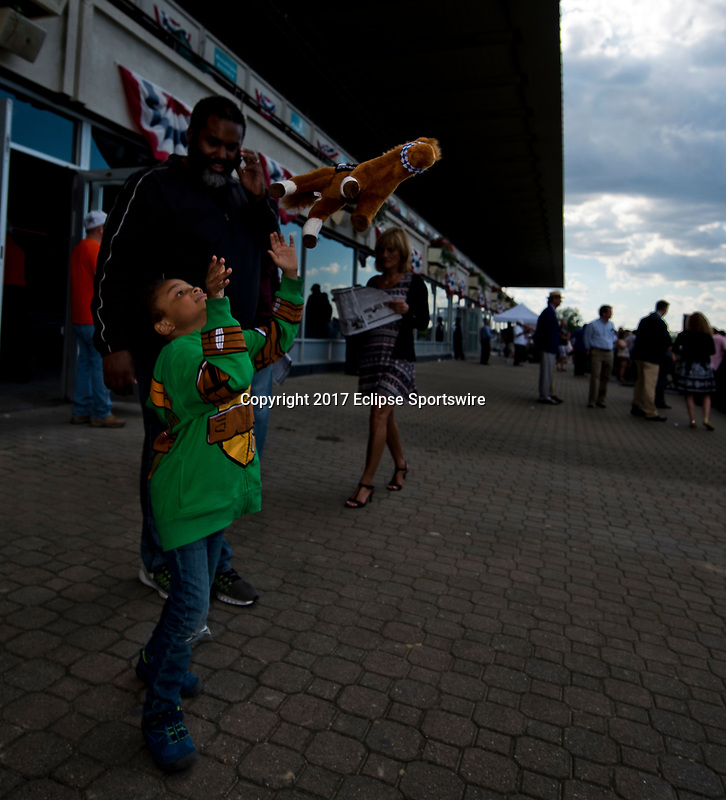 ELMONT, NY - JUNE 09: Young fans play with their stuffed race horses during Friday racing at the Belmont Stakes Racing Festival at Belmont Park on June 9, 2017 in Elmont, New York (Photo by Scott Serio/Eclipse Sportswire/Getty Images)
