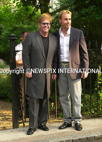 "ELTON JOHN AND  DAVID FURNISH TO MARRY.Sir Elton John is to marry his boyfriend David Furnish at the same venue as Prince Charles and Camilla Parker-Bowles..The singer and boyfriend posted their banns yesterday - on the day it became legal for homosexual couples to register to marry..The ceremony which be attended only by Elton's mother and stepfather and David's family, will be follwed by a lavish party at their £12 million Windsor mansion. Guests expected to include Liz Hurley, the Beckhams, Donetalla Versace and Rod Stewart..The ceremony will take place at Windsor Guildhall on 21st December, the first date on which gay couples can marry..©FRANCIS DIAS-NEWSPIX INTERNATIONAL..*MAY BE RETAIN FOR FUTURE USE*..**ALL FEES PAYABLE TO: ""NEWSPIX INTERNATIONAL""**..PHOTO CREDIT MANDATORY!!:©NEWSPIX INTERNATIONAL(Failure to credit will incur a surcharge of 100% of reproduction fees)..IMMEDIATE CONFIRMATION OF USAGE REQUIRED:.Newspix International, 31 Chinnery Hill, Bishop's Stortford, ENGLAND CM23 3PS.Tel:+441279 324672  ; Fax: +441279656877.Mobile:  0777568 1153.e-mail: photodesk.newspix@virgin.net"