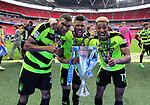 Huddersfield's Colin Quaner, Elias Kachunga and Rajiv Van La Parra celebrate with the trophy during the Championship Play-Off Final match at Wembley Stadium, London. Picture date: May 29th, 2017. Pic credit should read: David Klein/Sportimage