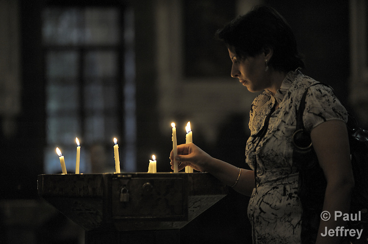 A worshipper lights candles in St. Paul's Melkite Greek Catholic Church in Damascus, Syria.