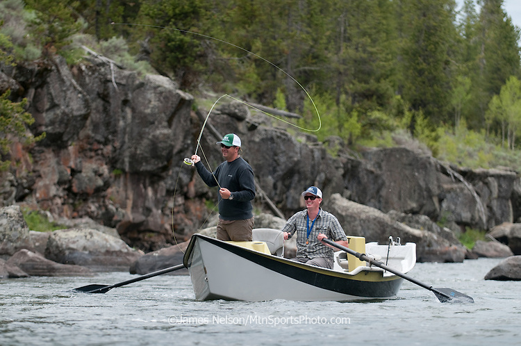An angler casts a fly for trout from a drift boat on the Henry's (North) Fork of the Snake River in eastern Idaho.