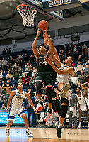 WASHINGTON, DC - JANUARY 29: Amir Harris #22 of George Washington clashes under the basket with Carter Collins #24 of Davidson during a game between Davidson and George Wshington at Charles E Smith Center on January 29, 2020 in Washington, DC.