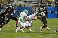 1 September 2011:  FIU linebacker Jordan Hunt (25), defensive lineman Andre Pound (75), and linebacker Winston Fraser (34) converge on North Texas running back Lance Dunbar (5) in the first half as the FIU Golden Panthers defeated the University of North Texas, 41-16, at FIU Stadium in Miami, Florida.