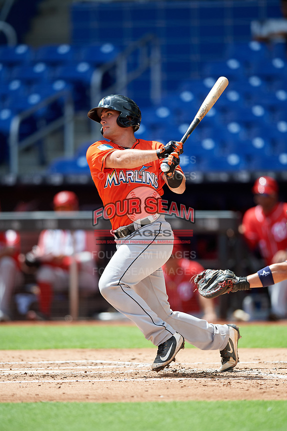 Miami Marlins catcher Nick Fortes (12) hits a single during a Florida Instructional League game against the Washington Nationals on September 26, 2018 at the Marlins Park in Miami, Florida.  (Mike Janes/Four Seam Images)