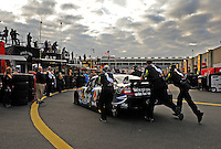 Oct. 15, 2009; Concord, NC, USA; NASCAR Sprint Cup Series driver Carl Edwards is pushed into the garage during practice for the Banking 500 at Lowes Motor Speedway. Mandatory Credit: Mark J. Rebilas-