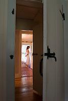 Woman wearing negligee standing in bathroom