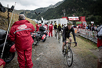 Nick Schultz (AUS/Mitchelton-Scott) riding towards the mountain gondolla to bring him back down off the mountain after finishing the stage where the weather turned foul in the finale<br /> <br /> Stage 9: Andorra la Vella to Cortals d'Encamp (94km) - ANDORRA<br /> La Vuelta 2019<br /> <br /> ©kramon