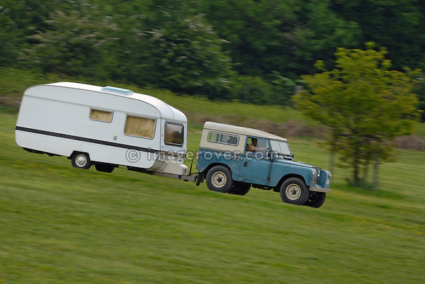 Series 2 SWB Land Rover towing a caravan to the ALRC National 2008. The Association of Land Rover Clubs (ALRC) National Rallye is the biggest annual motor sport oriented Land Rover event and was hosted 2008 by the Midland Rover Owners Club at Eastnor Castle in Herefordshire, UK, 22 - 27 May 2008. --- No releases available. Automotive trademarks are the property of the trademark holder, authorization may be needed for some uses.