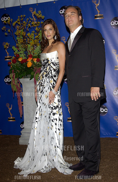 TERI HATCHER & JAMES BELUSHI at the 56th Annual primetime EMMY Awards at the Shrine Auditorium, Los Angeles..September 19, 2004