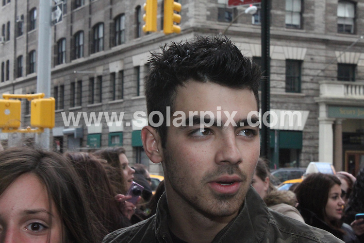 **ALL ROUND PICTURES FROM SOLARPIX.COM**                                             **SYNDICATION RIGHTS FOR UK, AUSTRALIA, DENMARK, PORTUGAL, S. AFRICA, SPAIN & DUBAI (U.A.E) & ASIA (EXCLUDING JAPAN) ONLY**                                                                                  Caption: Joe Jonas greets fans at the Trump Soho Hotel in New York City, USA. 13 March 2011                                                                       This pic: Joe Jonas                                                                                            JOB REF: 12961 PHZ Olzuk      DATE:  11_03_2011                                                          **MUST CREDIT SOLARPIX.COM OR DOUBLE FEE WILL BE CHARGED**                                                                      **MUST AGREE FEE BEFORE ONLINE USAGE**                               **CALL US ON: +34 952 811 768 or LOW RATE FROM UK 0844 617 7637**