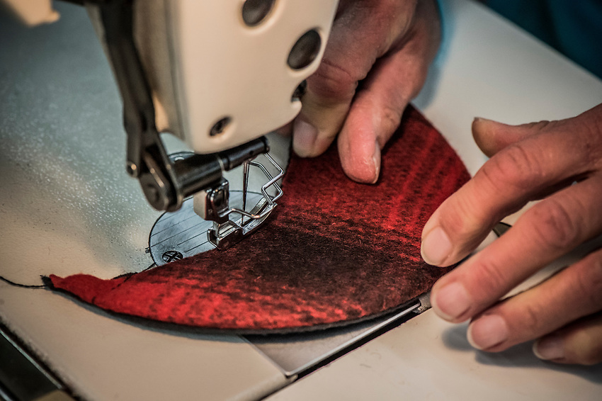 A step in the Stormy Kromer manufacturing process attaching the hat brim at the Ironwood, Michigan production facility.