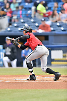 Kannapolis Intimidators center fielder Joel Booker (23) squares to bunt during a game against the Asheville Tourists at McCormick Field on April 18, 2017 in Asheville, North Carolina. The Intimidators defeated the Tourists 6-1. (Tony Farlow/Four Seam Images)