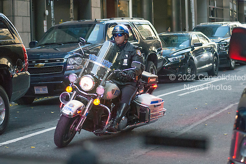A NYPD motorcycle leads the motorcade for President-elect Trump as he travels from Trump Tower to Laguardia Airport for a series of visits to Indianapolis and Cincinnati, in New York, NY, USA on December 1, 2016. <br /> Credit: Albin Lohr-Jones / Pool via CNP