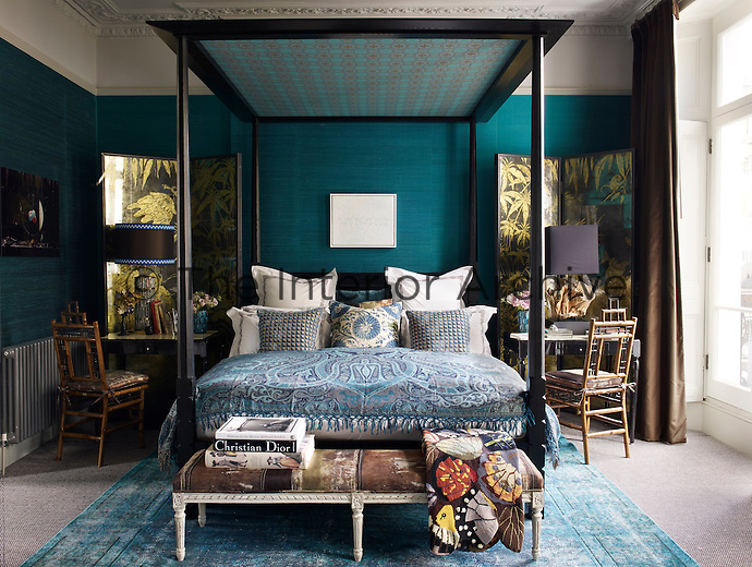 In the master bedroom, the bamboo chairs were found at a Paris flea market and the desks came from a Madrid jewellery store; the screens are by Nominka D'Albarella