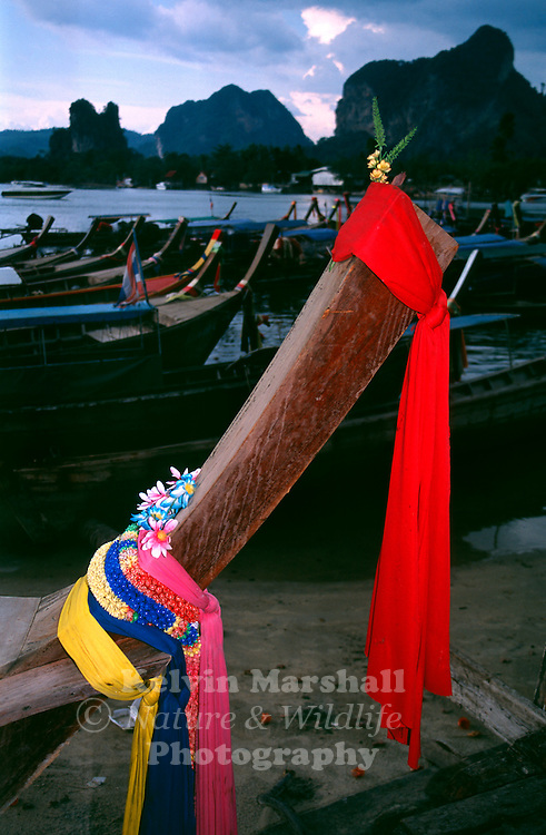 The long-tail boat, known as Ruea Hang Yao. These boats displaying flowing ribbons on the bow to appease the sea spirits. Ao Nang, Krabi Province - Thailand.