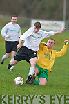 Rockmounts Fran Frawley fouls Stephen Hayes (Killarney Celtic) just as he prepares a pile driver during their FAI Junior cup clash in Killarney on Sunday.  .