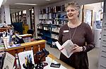 WOODBURY CT. 16 March 2018-031619SV06-Sue Piel, Director, works the circulation desk at the library in Woodbury Saturday.<br /> Steven Valenti Republican-American