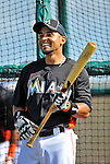 13 March 2012: Miami Marlins infielder Omar Infante awaits his turn in the batting cage prior to a Spring Training game against the Atlanta Braves at Roger Dean Stadium in Jupiter, Florida. The two teams battled to a 2-2 tie playing 10 innings of Grapefruit League action. Mandatory Credit: Ed Wolfstein Photo
