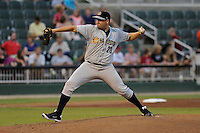 Pitcher Omar Luis (20) of the Charleston RiverDogs delivers a pitch in a game against the Kannapolis Intimidators on Saturday, June 28, 2014, at CMC-Northeast Stadium in Kannapolis, North Carolina. Kannapolis won, 4-3. (Tom Priddy/Four Seam Images)