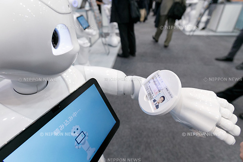 SoftBank's humanoid robot Pepper scans an ID during SoftBank Robot World 2017 on November 21, 2017, Tokyo, Japan. SoftBank Robotics organized SoftBank Robot World 2017 to introduce AI (Artificial Intelligence) and IoT (the Internet of Things) companies developing the latest technology for robots, including applications its humanoid robot Pepper in various business fields. The robot expo runs until November 22. (Photo by Rodrigo Reyes Marin/AFLO)