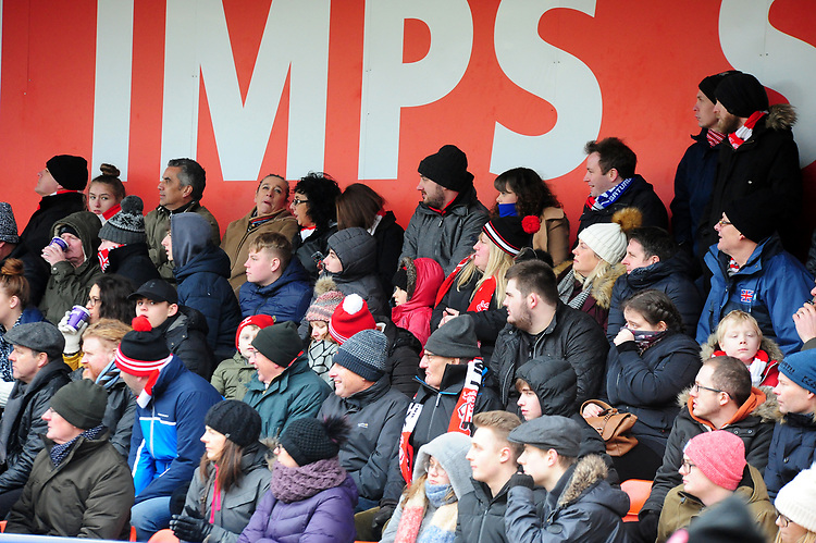 Lincoln City fans watch their team in action<br /> <br /> Photographer Andrew Vaughan/CameraSport<br /> <br /> The EFL Sky Bet League Two - Lincoln City v Grimsby Town - Saturday 19 January 2019 - Sincil Bank - Lincoln<br /> <br /> World Copyright &copy; 2019 CameraSport. All rights reserved. 43 Linden Ave. Countesthorpe. Leicester. England. LE8 5PG - Tel: +44 (0) 116 277 4147 - admin@camerasport.com - www.camerasport.com