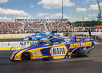 Jun 6, 2016; Epping , NH, USA; NHRA funny car driver Ron Capps (near) races alongside John Force during the New England Nationals at New England Dragway. Mandatory Credit: Mark J. Rebilas-USA TODAY Sports