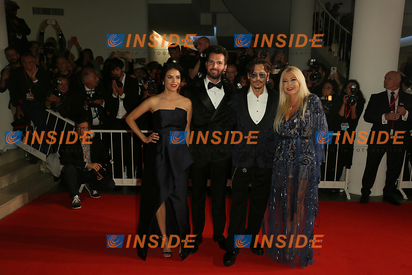 "VENICE, ITALY - SEPTEMBER 06: (L-R)  Andrea Iervolino, Olga Segura, Johnny Depp and Monika Bacardi walk the red carpet ahead of the ""Waiting For The Barbarians"" screening during the 76th Venice Film Festival at Sala Grande on September 06, 2019 in Venice, Italy. (Photo by Mark Cape/Insidefoto)<br /> Venezia 06/09/2019"