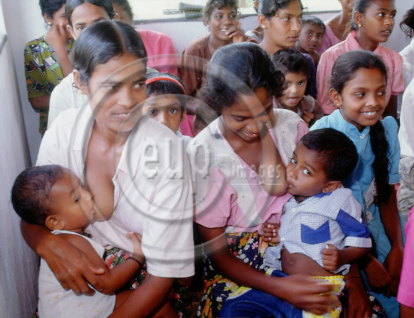 (97/18/19)-Anuradhapura-Sri Lanka - January 08, 1997---Women breastfeeding their boys during a village meeting; FNS/SAN, rural---Photo: Horst Wagner/eup-images