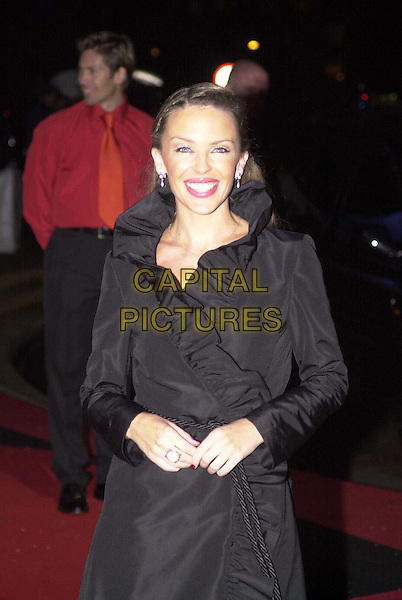 KYLIE MINOGUE.Arrivals for the Brit Awards at Earls Court..black wrap dress, half length, half-length.*RAW SCAN - photo will be adjusted for publication*.www.capitalpictures.com.sales@capitalpictures.com.© Capital Pictures