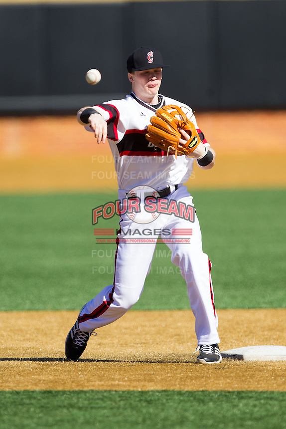 Ian Happ (5) of the Cincinnati Bearcats makes a throw to first base during infield practice prior to the game against the Radford Highlanders at Wake Forest Baseball Park on February 22, 2014 in Winston-Salem, North Carolina.  The Highlanders defeated the Bearcats 6-5.  (Brian Westerholt/Four Seam Images)