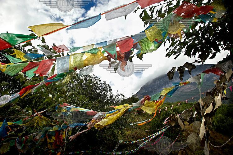 Prayer flags fly near the legendary Lugu Hu Lake. /Felix Features