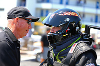 May 6, 2017; Commerce, GA, USA; NHRA top fuel driver Chris Karamesines (right) talks with Pat Dakin during qualifying for the Southern Nationals at Atlanta Dragway. Mandatory Credit: Mark J. Rebilas-USA TODAY Sports