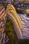 Waterfall over a dam in Menomonee Falls Wisconsin