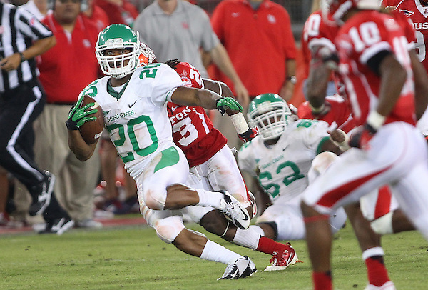 Denton, TX - OCTOBER 6: Running back Jeremy Brown #20 of the North Texas Mean Green in action against the Houston Cougars at Robertson Stadium in Houston on October 6, 2012 in Houston, Texas. Photo by: Rick Yeatts