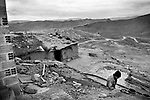 Potosi, Bolivia. A miner leaving his house next to the mine. Many miners spend continuous days in the mines, sleeping in poor muddy huts.