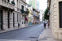 in the San Telmo district around Plaza Dorrego Square, a old houses around the square, all now housing antique shops., people walking on the street. Calle Defensa Defence street Buenos Aires Argentina, South America