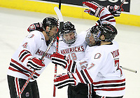 Nebraska-Omaha's Tony Turgeon (4), Brock Montpetit (12), and Michael Young (7) celebrate Ryan Walters's (19) goal. Colorado College defeated Nebraska-Omaha 5-2 Saturday night at CenturyLink Center in Omaha. (Photo by Michelle Bishop) .