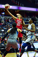 Washington, DC - May 27, 2018: Washington Mystics guard Kristi Toliver (20) goes up for a lay up over Minnesota Lynx defenders during game between the Mystics and Lynx at the Capital One Arena in Washington, DC. (Photo by Phil Peters/Media Images International)