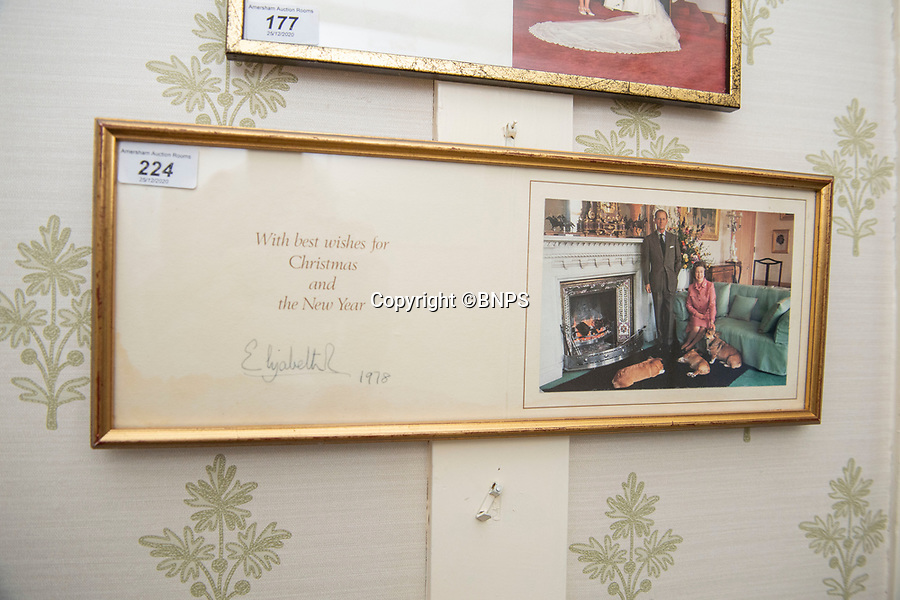 BNPS.co.uk (01202 558833)<br /> Pic: PhilYeomans/BNPS<br /> <br /> Royal Christmas cards sent from the Queen.<br /> <br /> A remarkable 'time warp' Royal archive amassed by the Queen's dressmaker has been found inside his old country home.<br /> <br /> The late Ian Thomas was a dress designer for members of the Royal Family, including Her Majesty, for over 30 years.<br /> <br /> As an apprentice he worked alongside the renowned fashion designer Norman Hartnell on creating the Queen's coronation dress in 1953.<br /> <br /> His archive includes embroidered samples of the gown worn by Elizabeth II for the historic ceremony in Westminster Abbey that was broadcast to millions.<br /> <br /> Mr Thomas also designed outfits for the Queen Mother and Princess Margaret.