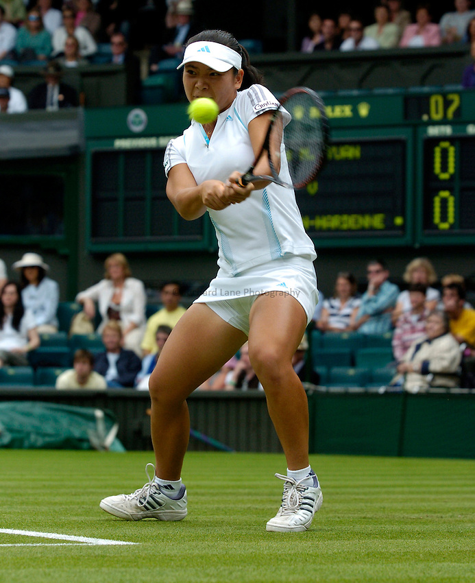 Photo: Richard Lane..Wimbledon Championships. 27/06/2006. .Meng Yuan of China returns.