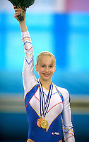 Sandra Izbasa of Romania celebrates winning gold in women's senior floor exercise final at 2006 European Championships Artistic Gymnastics at Volos, Greece on April 30, 2006. (Photo by Tom Theobald)<br />