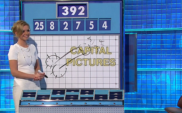 Rachel Riley, co-host of '8 Out of 10 Cats Does Countdown' Channel 4 TV game show in which contestants calculate a given number using smaller numbers., draws a cock at the instigation of Jon Richardson. England. Friday 19th April 2012.Screengrab half length white board drawing penis numbers maths 392 25 8 2 7 5 4.*Editorial Use Only*.CAP/PLF..Supplied by Capital Pictures..
