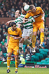 Shaun Hutchinson gets his head to the ball to clear from Georgios Samaras and Anthony Stokes as Tim Clancy waits