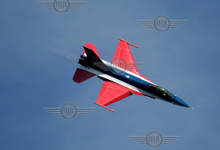"?Lockheed Martin F-16 fighter plane painted in the colors of the Norwegian flag. Display over over Oslo as The Royal Norwegian Air Force celebrate ""100 years of airpower""."