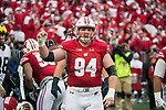 Wisconsin Badgers defensive lineman Conor Sheehy (94) celebrates a turnover on defense during an NCAA College Big Ten Conference football game against the Michigan Wolverines Saturday, November 18, 2017, in Madison, Wis. The Badgers won 24-10. (Photo by David Stluka)